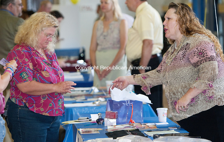 TORRINGTON, CT. 03 June 2010-060310SV05--From left, Rita Pfaender of Torrington sings up to sell Avon from Christina Cliff-Lataif during the Northwest Chamber's job fair at Torrington Armory in Torrington Thursday. Pfaender was happy because she was going to make some money from selling Avon while looking for a more full time job.<br /> Steven Valenti Republican-American