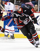 Mike Hewkin (Northeastern - 28) - The visiting Northeastern University Huskies defeated the University of Massachusetts-Lowell River Hawks 3-2 with 14 seconds remaining in overtime on Friday, February 11, 2011, at Tsongas Arena in Lowelll, Massachusetts.