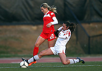 COLLEGE PARK, MARYLAND - April 03, 2013:  Stephanie Ochs (22) of The Washington Spirit is tackled by Erika Nelson (15) of the University of Maryland women's soccer team in a NWSL (National Women's Soccer League) pre season exhibition game at Ludwig Field in College Park Maryland on April 03. Maryland won 2-0.