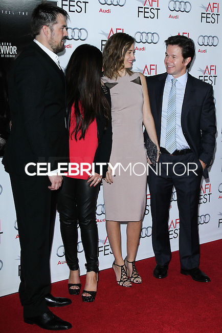 """HOLLYWOOD, CA - NOVEMBER 12: Marcus Luttrell, Melanie Juneau, Rhea Durham, Mark Wahlberg at the AFI FEST 2013 - """"Lone Survivor"""" Premiere held at TCL Chinese Theatre on November 12, 2013 in Hollywood, California. (Photo by David Acosta/Celebrity Monitor)"""
