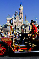 Fairy tale Castle and a Driver in a red veteran bus at Disney World, Florida, USA