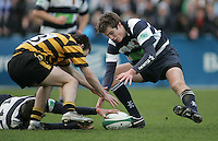 R.B.A.I. centre Adam McCarthy and Wallace centre Matthew Arneill grapple for this loose ball during the Northern Bank Schools Cup Final at Ravenhill. Result Wallace 0pts R.B.A.I. 15pts.