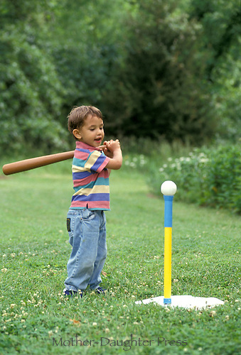 Boy playing T-ball