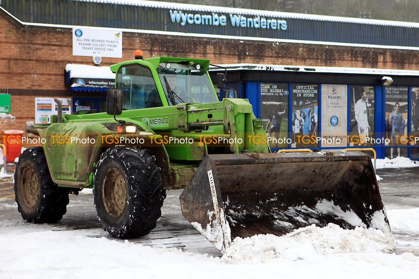 A snowplough clears the car park prior to the match at Wycombe - Wycombe Wanderers vs Dagenham & Redbridge - NPower League Two Football at Adams Park, High Wycombe - 19/01/13 - MANDATORY CREDIT: Paul Dennis/TGSPHOTO - Self billing applies where appropriate - 0845 094 6026 - contact@tgsphoto.co.uk - NO UNPAID USE.