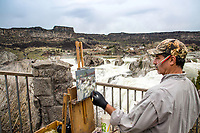 A painter capturing the record river flows of the Snake River at Shoshone Falls in spring 2017.  Shoshone Falls is in Twin Falls, Idaho.