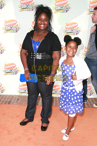 TANGIE CUNNINGHAM & MONICA LEWIS.20th Annual Nickelodeon Kids' Choice Awards held at UCLA's Pauley Pavilion, Westwood, California, USA..March 31st, 2007.full length jeans denim black white blue polka dot dress holding hands clutch purse .CAP/ADM/CH.©Charles Harris/AdMedia/Capital Pictures