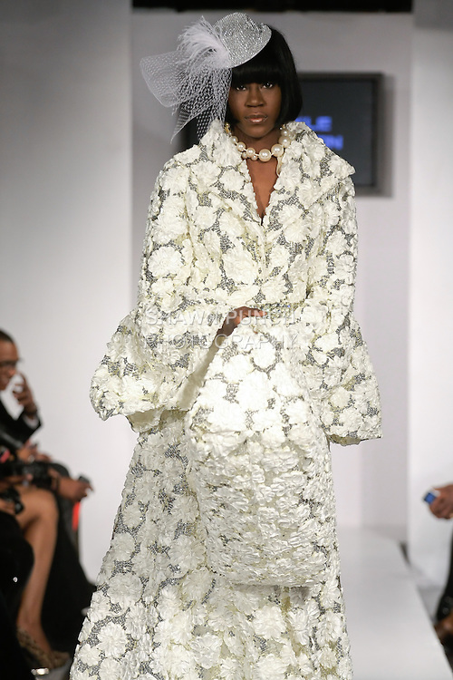 "Model walks runway in an Bridal gown from the Jewel Shannon ""Island Pearl"" collection, during BK Fashion Weekend Fall Winter 2012."