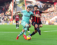 Nathan Ake of AFC Bournemouth tackles Henrikh Mkhitaryan of Arsenal during AFC Bournemouth vs Arsenal, Premier League Football at the Vitality Stadium on 25th November 2018