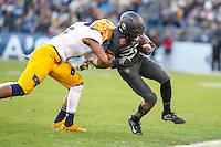 Baltimore, MD - December 10, 2016: Army Black Knights running back PaulAndrew Rhoden (23) gets pushed out of bounds during game between Army and Navy at  M&T Bank Stadium in Baltimore, MD.   (Photo by Elliott Brown/Media Images International)