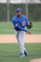 Esmailin Caridad #33 of the Chicago Cubs participates in pitchers fielding practice during spring training workouts at the Cubs complex on February 19, 2011  in Mesa, Arizona. .Photo by Bill Mitchell / Four Seam Images.