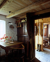 The kitchen is separated from the parlour by the stone flagged entrance hall
