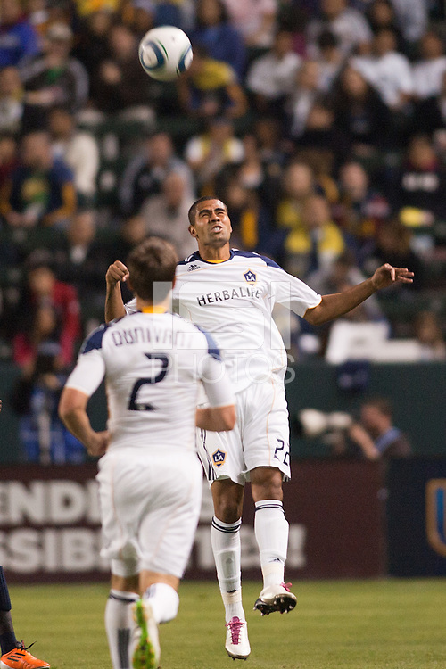 Leonardo (22) of the LA Galaxy with a headball. The LA Galaxy defeated the Philadelphia Union 1-0 at Home Depot Center stadium in Carson, California on  April  2, 2011....
