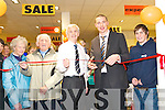RED TAPE: Kieran Donaghy cutting the ribbon to officially open the new McKenna's showroom in their Listowel store on Saturday with the help of Jack McKenna and Paul Taylor.   Copyright Kerry's Eye 2008