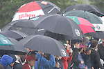 Ryder Cup 206 K Club, Straffan, Ireland..Ryder Cup fans get yet another soaking during the morning fourballs session of the second day of the 2006 Ryder Cup at the K Club in Straffan, Co Kildare, in the Republic of Ireland, 23 September 2006...Photo: Eoin Clarke/ Newsfile.