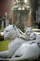 Lion statue i the grounds of the Dolmabahce Palace, Istanbul, Turkey, looking at Ottoman portraits
