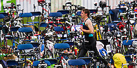 13 JUN 2010 - BEAUVAIS, FRA - A competitor runs through transition during the Beauvais Triathlon (PHOTO (C) NIGEL FARROW)