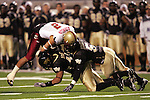 4 November 2006: Wake Forest's Stanley Arnoux (43) and Jon Abbate (5) go low to stop Boston College's Brandon Robinson (2). Wake Forest defeated Boston College 21-14 at Groves Stadium in Winston-Salem, North Carolina in an Atlantic Coast Conference college football game.