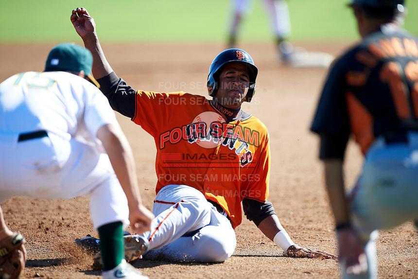 San Francisco Giants minor league outfielder Rafael Rodriguez #45 slides into third during an instructional league game against the Oakland Athletics at the Papago Park Baseball Complex on October 17, 2012 in Phoenix, Arizona. (Mike Janes/Four Seam Images)