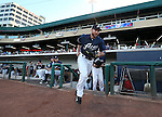 Reno Aces' Roger Kieschnick takes the field for a game in Reno, Nev., on Saturday, Sept. 6, 2014. The Reno Aces defeated the Las Vegas 51s, 7-3, to win the Pacific Conference Championship Series. <br /> Photo by Cathleen Allison