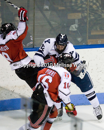 Jerry D'Amigo (RPI - 9), Ken Trentowski (Yale - 12) - The Rensselaer Polytechnic Institute (RPI) Engineers defeated the Yale University Bulldogs 4-0 on Saturday, January 30, 2010, at Ingalls Rink in New Haven, Connecticut.