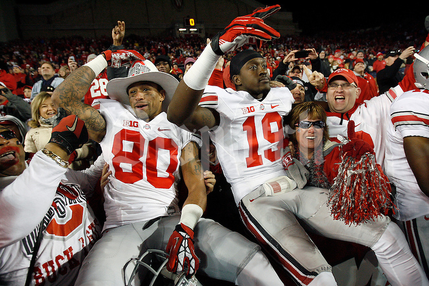 Ohio State Buckeyes wide receiver Chris Fields (80) and Ohio State Buckeyes defensive back Orhian Johnson (19) celebrated after beating Wisconsin Badgers in overtime of their college football game at Camp Randall Stadium in Madison, Wis, November 17, 2012.  (Dispatch photo by Kyle Robertson)