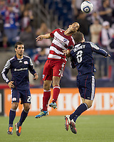 FC Dallas midfielder Daniel Cruz (7) and New England Revolution midfielder Chris Tierney (8) battle for head ball. In a Major League Soccer (MLS) match, the New England Revolution defeated FC Dallas, 2-0, at Gillette Stadium on September 10, 2011.