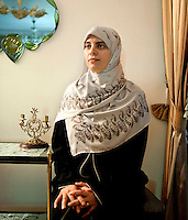 Nosayba Ashraf, 30 years old, is the Head of Research unit in the Foreign Relation comittee in FJP. Nosayba is part of the Muslim Brotherhood since she was 17; she has two children. Here she poses in Amal Abdel El-Karim's apartment in Doqqi district - Amal is in charge of the women section of FJP in Giza. Cairo, Egypt. October 2012.<br />
