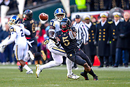 PHILADELPHIA, PA - DEC 8, 2018: Army Black Knights running back Kell Walker (5) makes the catch over Navy Midshipmen safety Juan Hailey (13) during game between Army and Navy at Lincoln Financial Field in Philadelphia, PA. Army defeated Navy 17-10 to win the Commander in Chief Cup. (Photo by Phil Peters/Media Images International)