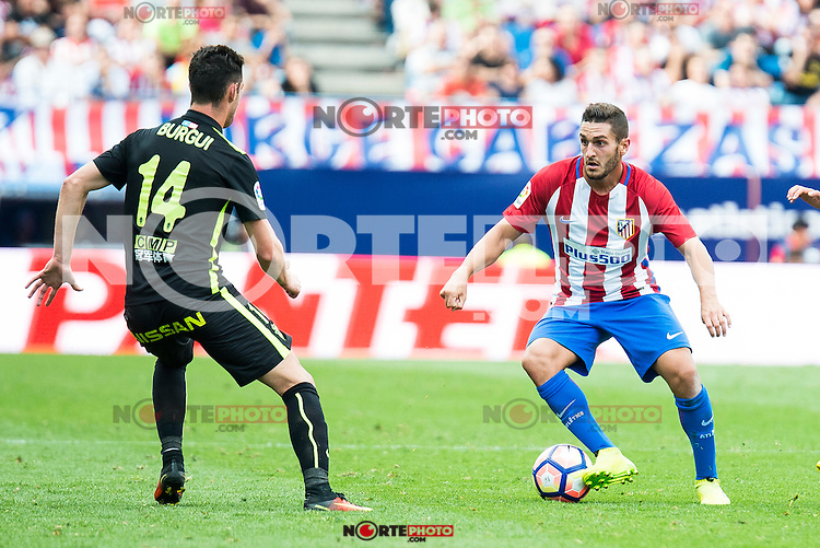 Atletico de Madrid's player Koke Resurrección and Sporting de Gijon's Burgui during a match of La Liga Santander at Vicente Calderon Stadium in Madrid. September 17, Spain. 2016. (ALTERPHOTOS/BorjaB.Hojas) /NORTEPHOTO