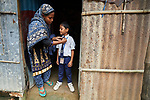 Rehena Akhter gets her son Borna ready for school in Suihari in northern Bangladesh. Devastating floods in August 2017 affected thousands of families across the region, and Akter and her family lost their home. Today they live with a neighbor, and she's hopeful she can soon borrow the money from a local savings group in order to start construction of her own home.<br /> <br /> While families in the area were still displaced by high waters, Christian Aid and the Christian Commission for Development Bangladesh, both members of the ACT Alliance, worked together to provide emergency food packages to vulnerable residents, including Akter and her family.