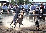 Justin Edgeman competes in the calf roping event at the Minden Ranch Rodeo on Saturday, July 23, 2011, in Gardnerville, Nev..Photo by Cathleen Allison