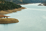 Shore of reservoir showing effects of drought, Don Pedro Reservoir, California