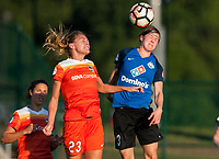 Kansas City, MO - Sunday July 02, 2017:  Becca Moros heads the ball away from Cami Privett during a regular season National Women's Soccer League (NWSL) match between FC Kansas City and the Houston Dash at Children's Mercy Victory Field.