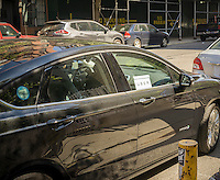 An Uber livery waits for their passenger in Greenwich Village in New York on Wednesday, July 22, 2015. The New York City Council vote on capping the amount of Uber livery cars has been postponed after an agreement was made for Uber to supply more information and data.  (© Richard B. Levine)