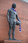 The statue of John Greig with scarves to remember the 66 people who died at Ibrox Stadium in January 1971