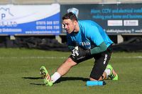 Woking goalkeeper, Craig Ross, warms up ahead of kick-off during Dartford vs Woking, Vanarama National League South Football at Princes Park on 23rd February 2019