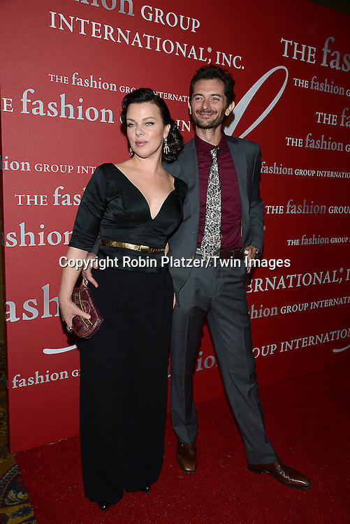 Debi Mazar and husband Gabriele Corcos attends the 31st Annual Night of Stars &quot;The Protagonists&quot;<br /> presented by The Fashion Grouip International on October 23, 2014 at Cipriani Wall Street in New York City. <br /> <br /> photo by Robin Platzer/Twin Images<br />  <br /> phone number 212-935-0770