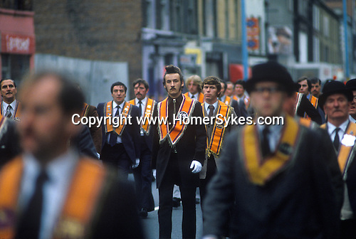 Belfast The Troubles. 1980s. Orange Day parade central Belfast.