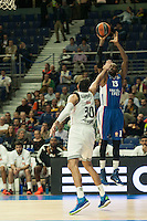 Real Madrid´s Ioannis Bourousis and Anadolu Efes´s Stephane Lasme during 2014-15 Euroleague Basketball match between Real Madrid and Anadolu Efes at Palacio de los Deportes stadium in Madrid, Spain. December 18, 2014. (ALTERPHOTOS/Luis Fernandez) /NortePhoto /NortePhoto.com