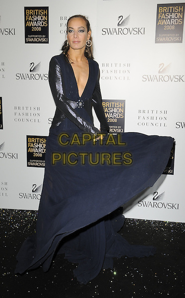TARA PALMER TOMKINSON.Inside arrivals at the British Fashion Awards 2008 held at The Lawrence Hall in London, England. UK, .November 25th 2008.full length TPT long sleeved navy blue long maxi dress low cut v neck sheer plunging neckline gown leather shiny sleeves black twirling spinning .CAP/CAN.©Can Nguyen/Capital Pictures.