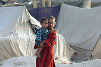 Refugee camp in South West Kabul Afghanistan near Charah Qambar. The refugees were from the Kandahar and Helmund provinces of Afghanistan. They had fled the fighting between the Taleban and Nato forces.