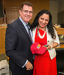 Houston ISD superintendent Dr. Terry Grier presents Baylor College of Medicine Academy at Ryan principal Jyoti Malhan with a hat during the monthly principals meeting, September 4, 2013.