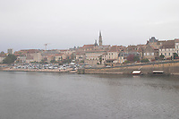 View over the Old Town Bergerac over the river Dordogne in autumn mist Bergerac Dordogne France