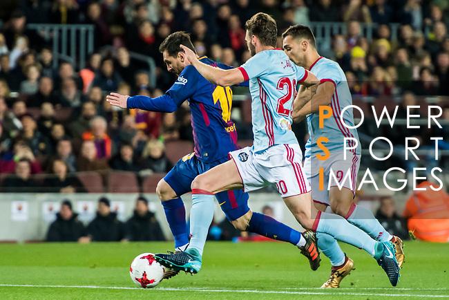 Lionel Andres Messi (L) of FC Barcelona is followed by Sergi Gomez Sola (C) and Jonathan Castro Otto, Jonny of RC Celta de Vigo during the Copa Del Rey 2017-18 Round of 16 (2nd leg) match between FC Barcelona and RC Celta de Vigo at Camp Nou on 11 January 2018 in Barcelona, Spain. Photo by Vicens Gimenez / Power Sport Images