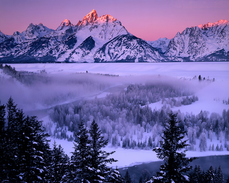 Foggy sunrise light on the Snake River and the Teton Range; Grand Teton National Park, WY