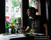 Pasquale dines at a fine Italian resturant in Bostons's North End, Dolce Vita. It is a profile portrait whihc speaks to his love of wonderful Italian food and fine red wine.