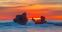Waves Crashing on Rocks at Sunset in Corona Del Mar California