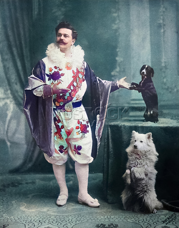 A famous tamer Vladimir Leonidovich Durov with his trained little dogs.