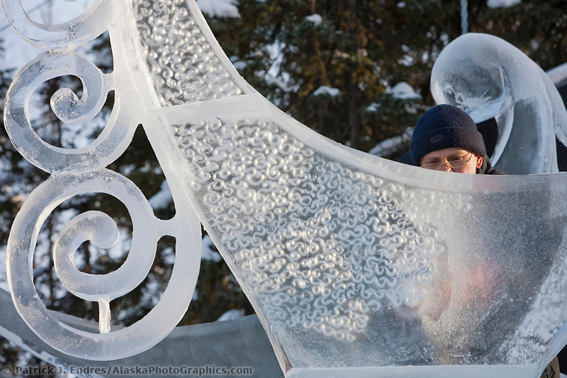 "Ice sculptor from Russia adds detail to a multi block sculpture titled ""The Tree Graces"" for the 2009 World Ice Art Championships in Fairbanks, Alaska. Team members: Sergey Tselebrovsky, Russia; Dimitry Gorokhov, Russia; Sergey Zaplatin, Russia; Andy GertlerNY, USA"