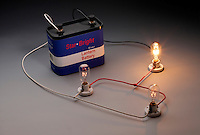 LIGHT BULBS IN A DC CIRCUIT<br /> (2 of 2)<br /> Three Bulbs- All Connected<br /> When bulb C is screwed in, bulb A gets brighter and B dims and has the same brightness as C.